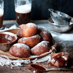Orange and ricotta donuts dipped into decadent chocolate sauce.