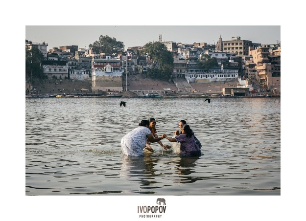 Women bathing in the shallow waters of Ganga river in Varanasi