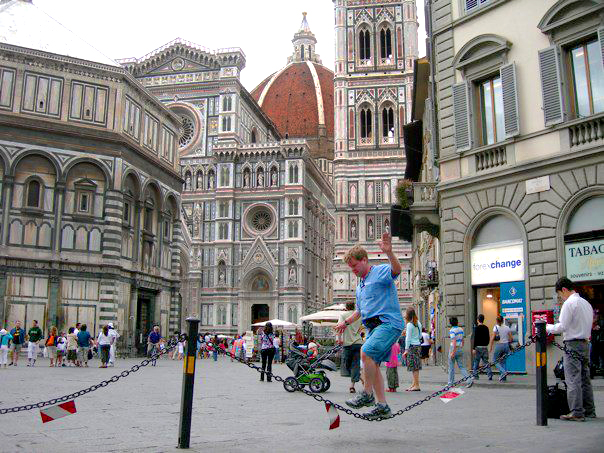 Rob Noonan slacklining on a chain in front of the Duomo in Florence.