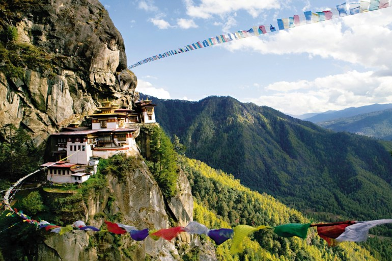 Image of Tiger's Nest Monastery with prayer flags in Bhutan