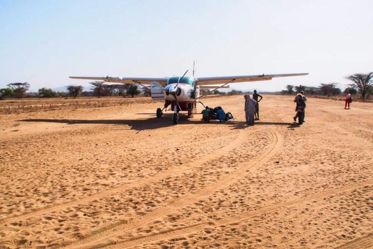 plane on dirt airstrip