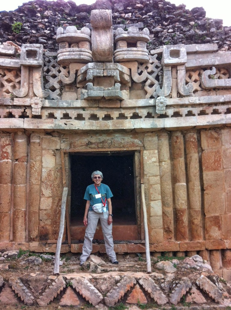 woman standing in front of Mayan temple