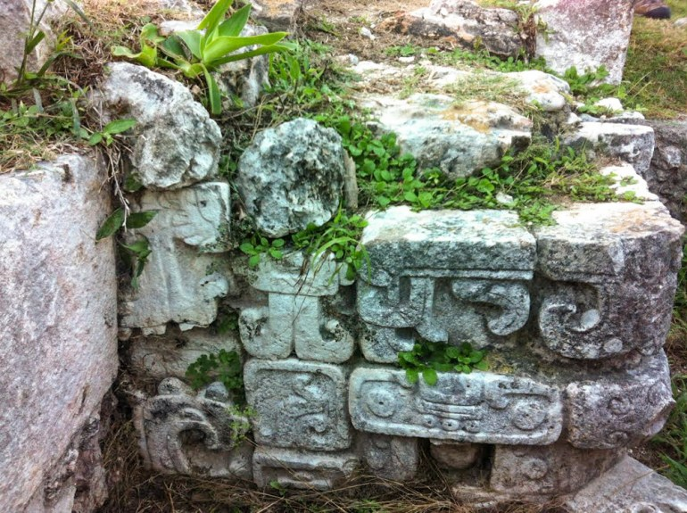 inscriptions on mayan temple ruins