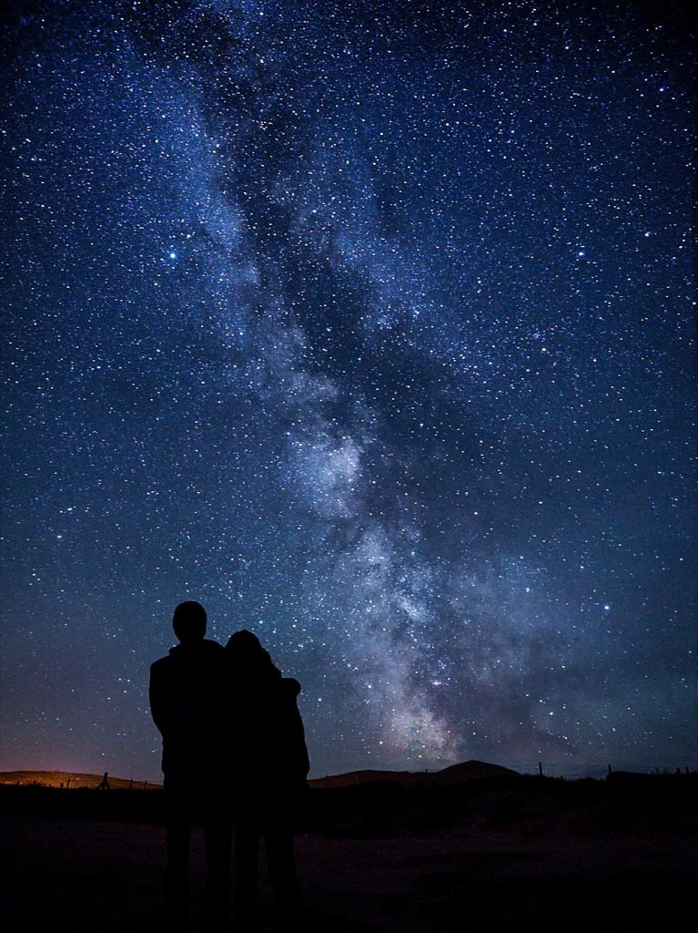 Couple beneath stars at Dingle Peninsula, Kerry County, Ireland