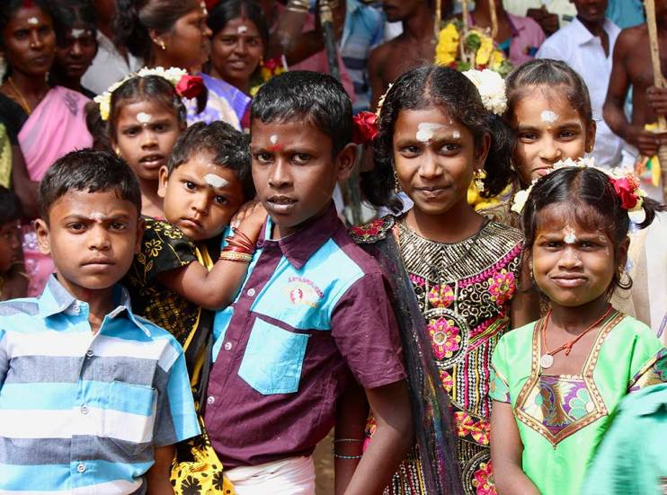 A group of children smiling in India