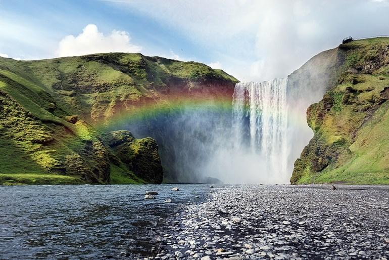 skogafoss waterfall with rainbow in iceland