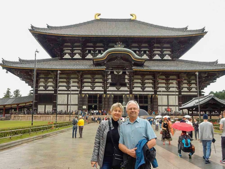 couple standing in front of temple in Japan