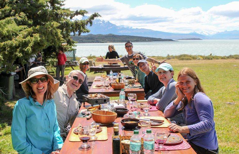 group eating a picnic at helsingfors estancia in patagonia