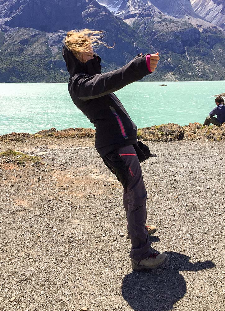 woman standing against wind in patagonia