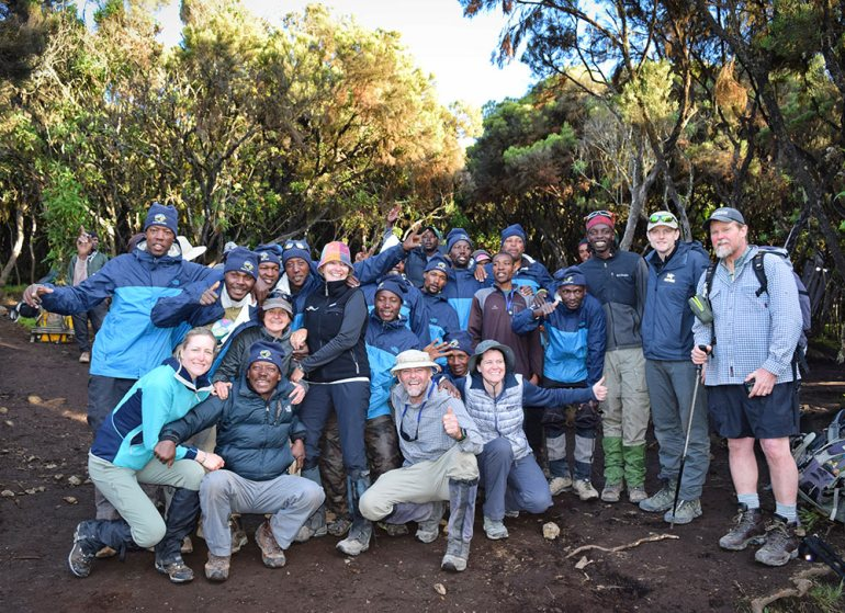 group photo after reaching the summit in kilimanjaro