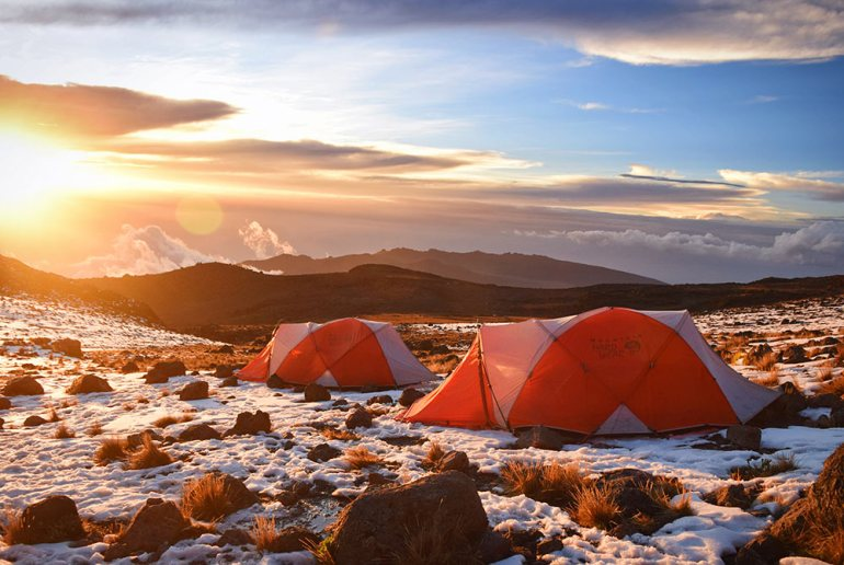 tents at sunrinse in kilimanjaro