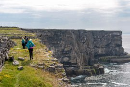 ireland-west-coast-hiker-near-sea-cliff