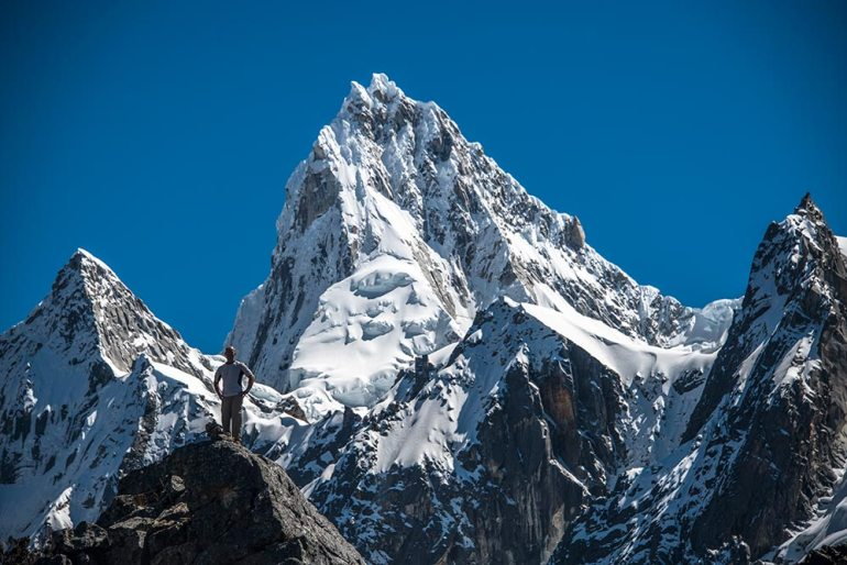 man and mountain in Cordillera Blanca