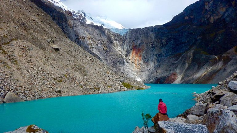 woman and lake in Cordillera Blanca