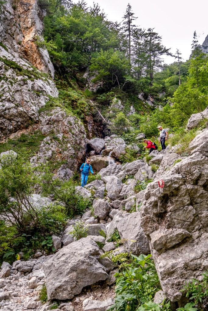 hiking over rocks in Slovenia