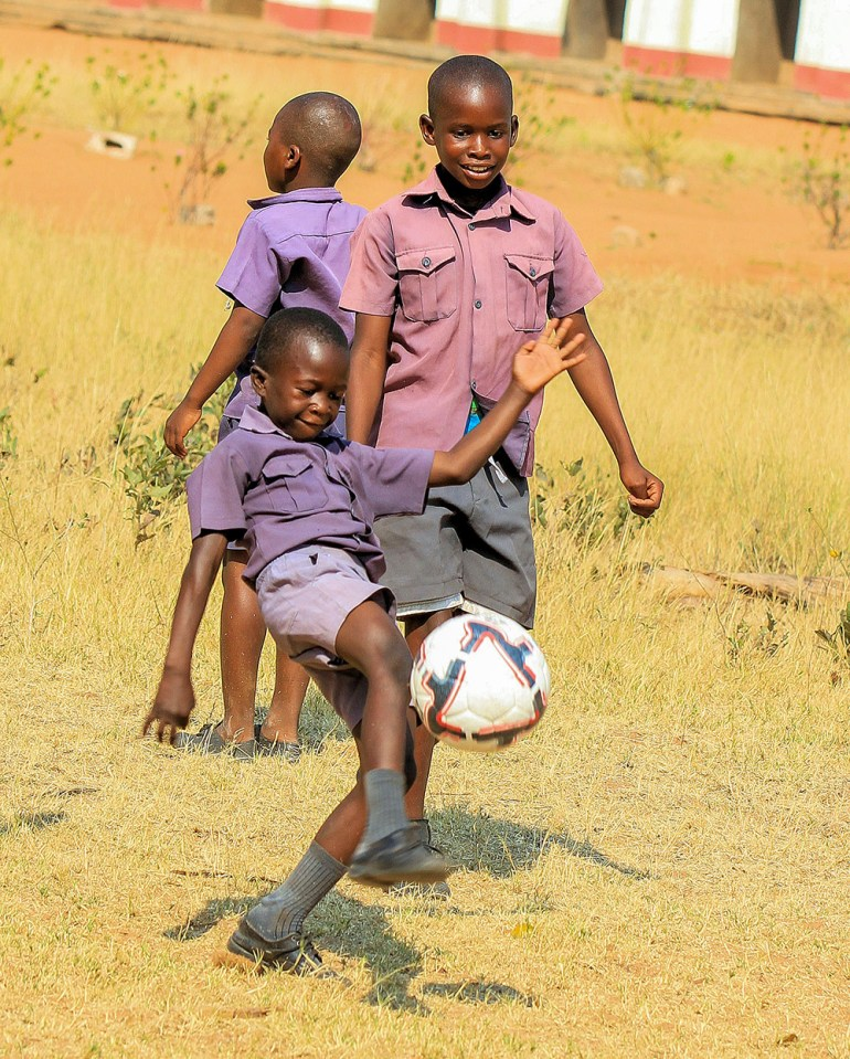 boys playing soccer in Zimbabwe