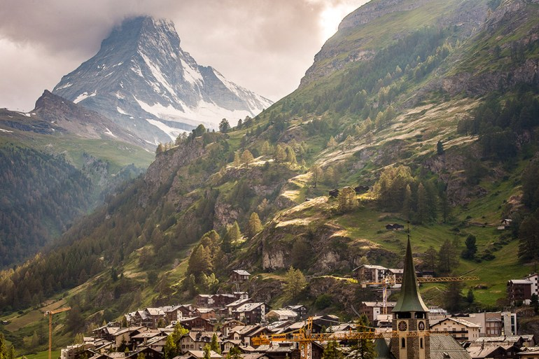 hiking into a city on the haute route