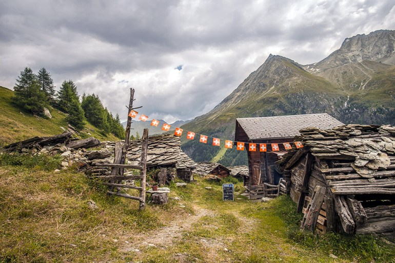 a hut with Swoss flags on the haute route
