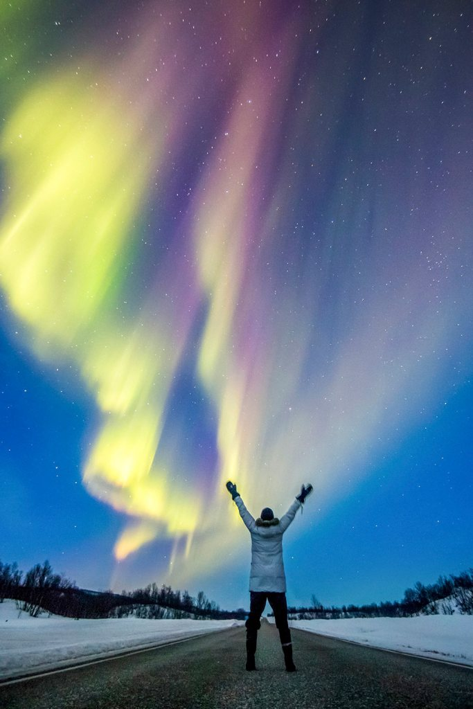 northern lights over hiker in finland