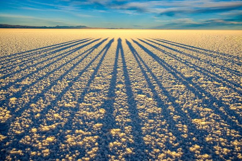 long shadows of group in Bolivia's Salar de Uyuni