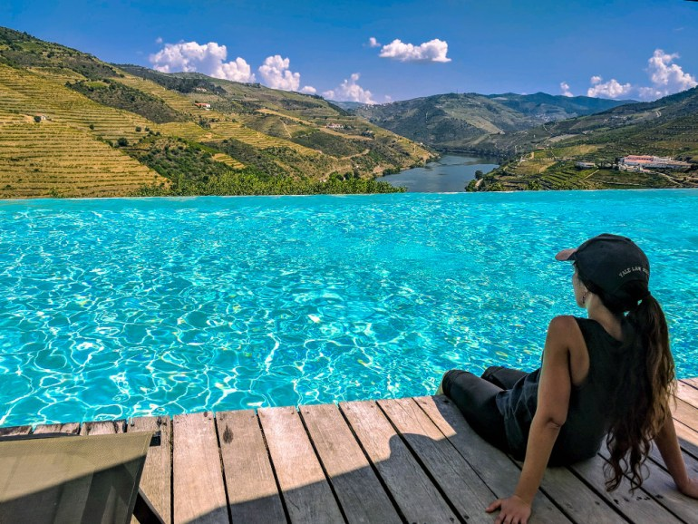 girl by pool in douro valley in portugal