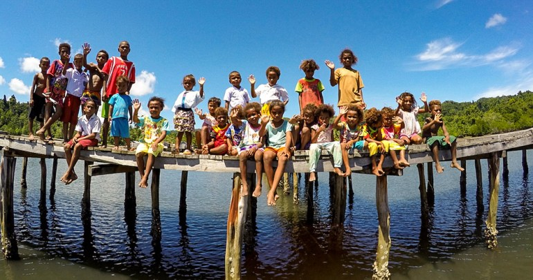 locals on dock raja ampat