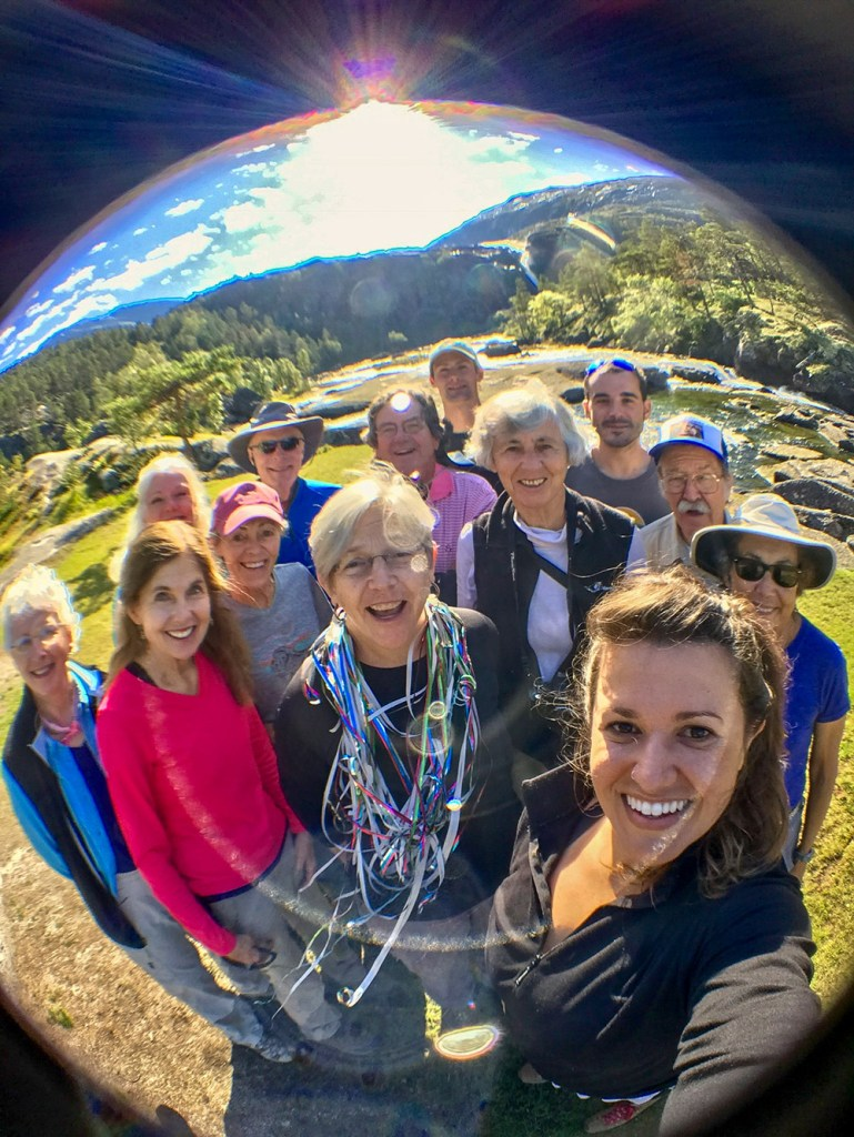 a fish-eye group photo in Norway