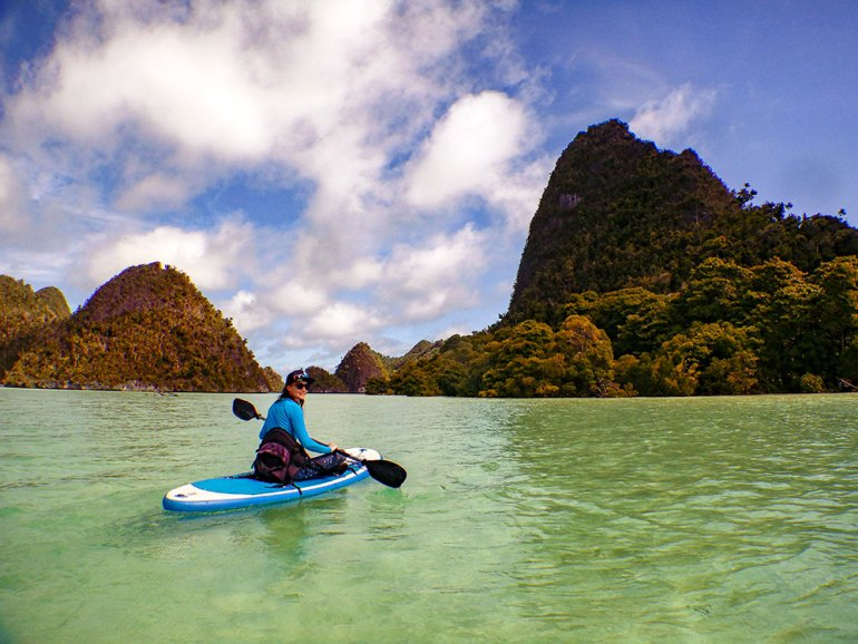 woman kayaker in Raja Ampat