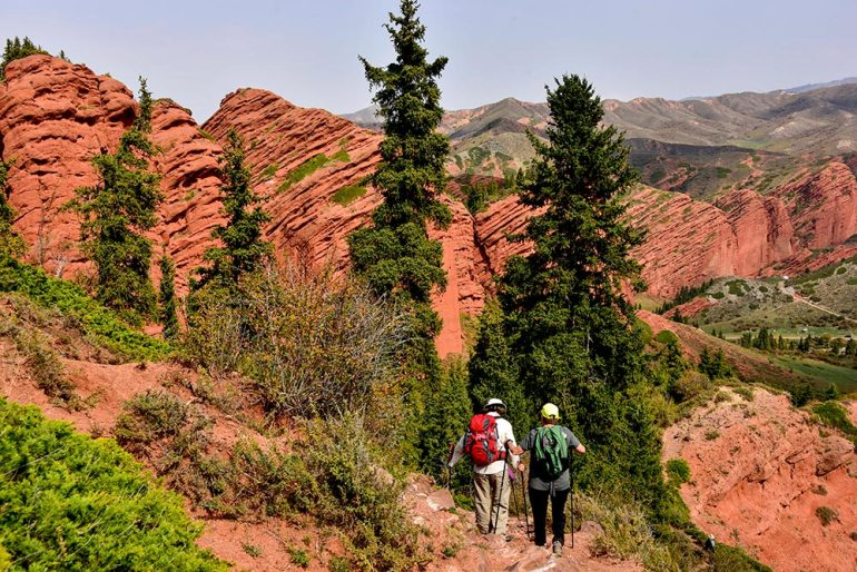 hiking in red rocks in Kyrgyzstan