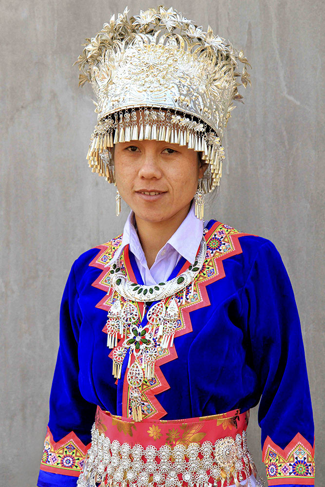 hmong woman in finery in indochine