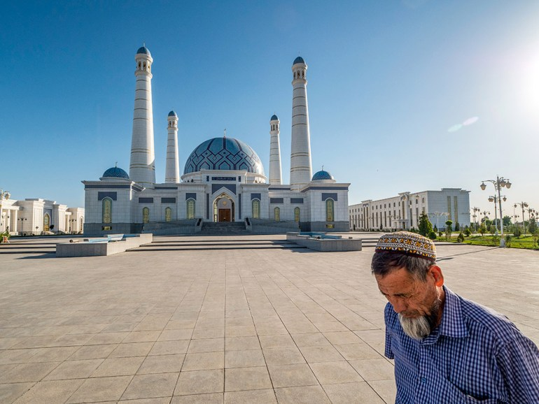 man near temple or mosque in central asia