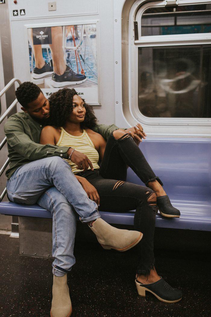 couple sitting on a subway