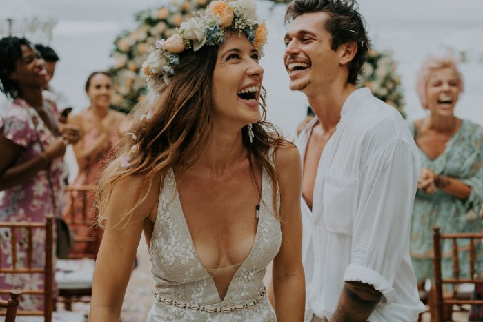 recessional photo bride and groom laughing