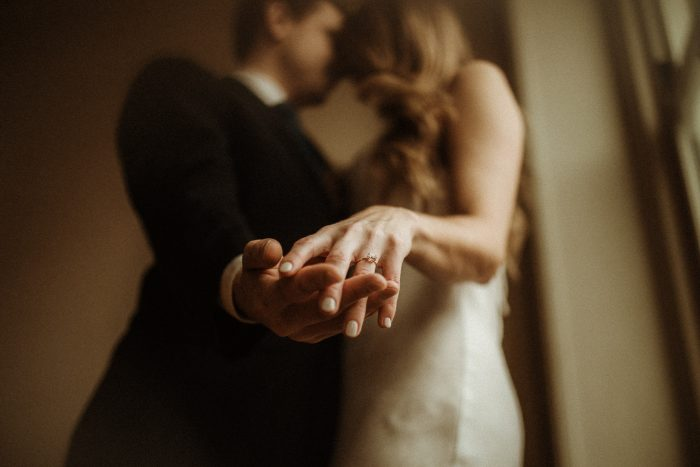 couple embracing holding hands