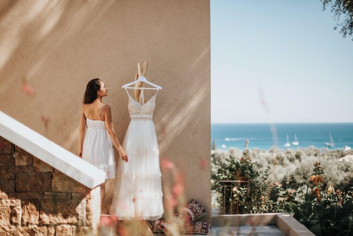 bride admiring dress in Greece