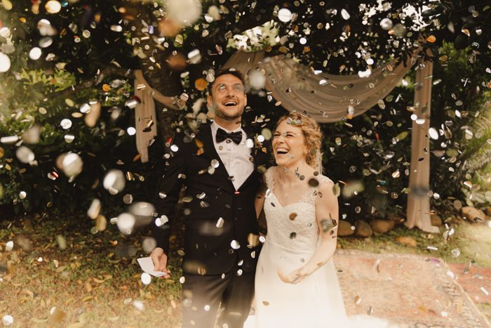newlywed couple underneath confetti