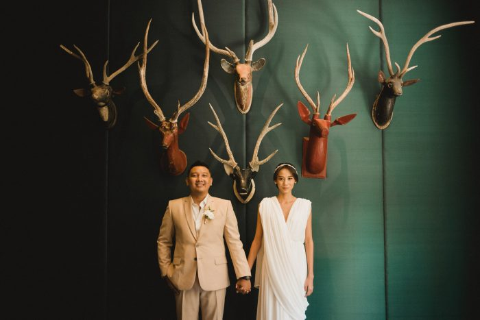 bride and groom with mounted deer