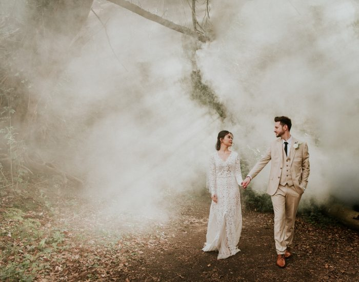top pic of month couple walking through fog