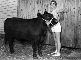 Anita Madsen of Hillsdale age 13 with her Champion at Col. Cty. Fair 1958