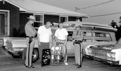 Greenport Rescue Squad's Andy Hart & Tom Wright with NYS Troopers Sgt. Fremontee & Trp. Jim Arre 1965