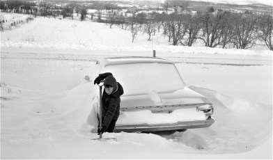 Tommy Gunther digging out Howie's car G'town Jan. 1964