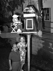 Lew & Louise pose with windmill at Central House 1970