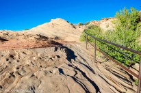 At this Page, Arizona scenic overlook, a walk down a slippery sandstone slope requires a steel handrail