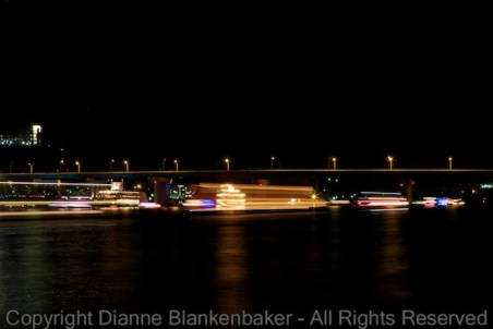 15 second exposure with boats in the background sitting still while boats in the foreground go by