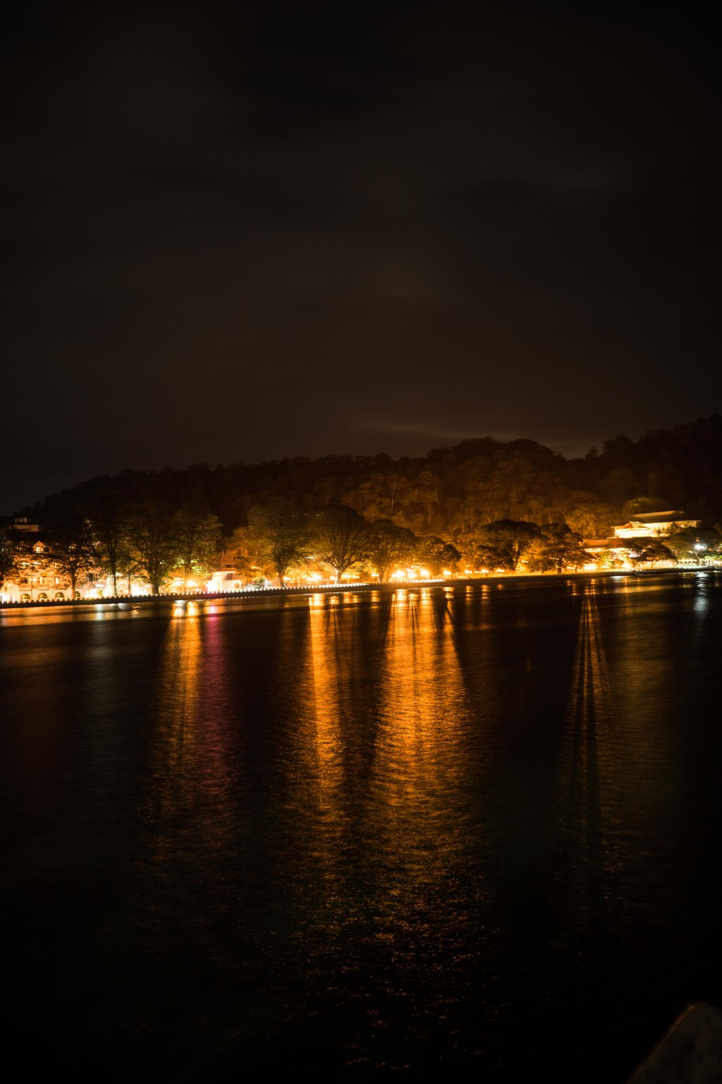 Lights reflecting off from the lake in Kandy at night