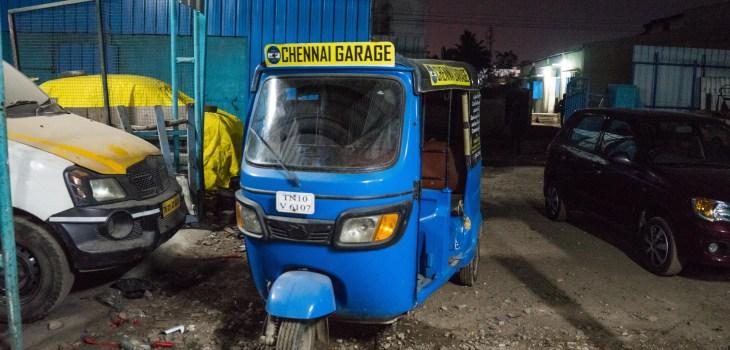 A blue rickshaw inside the Chennai Garage
