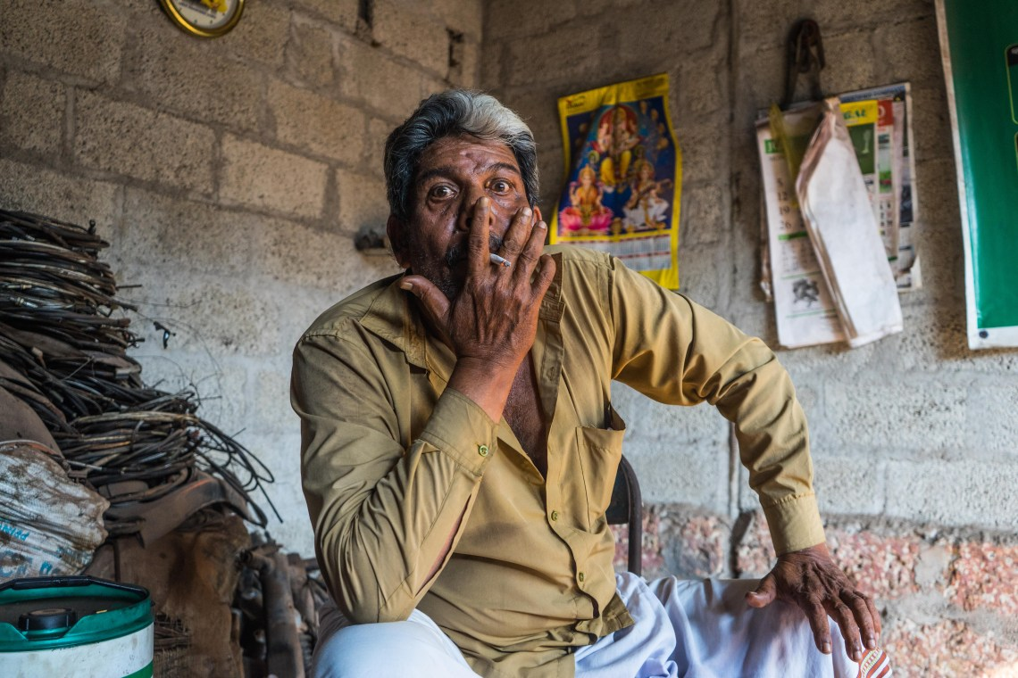 Asaf, a rickshaw-driver, smoking his cigarette