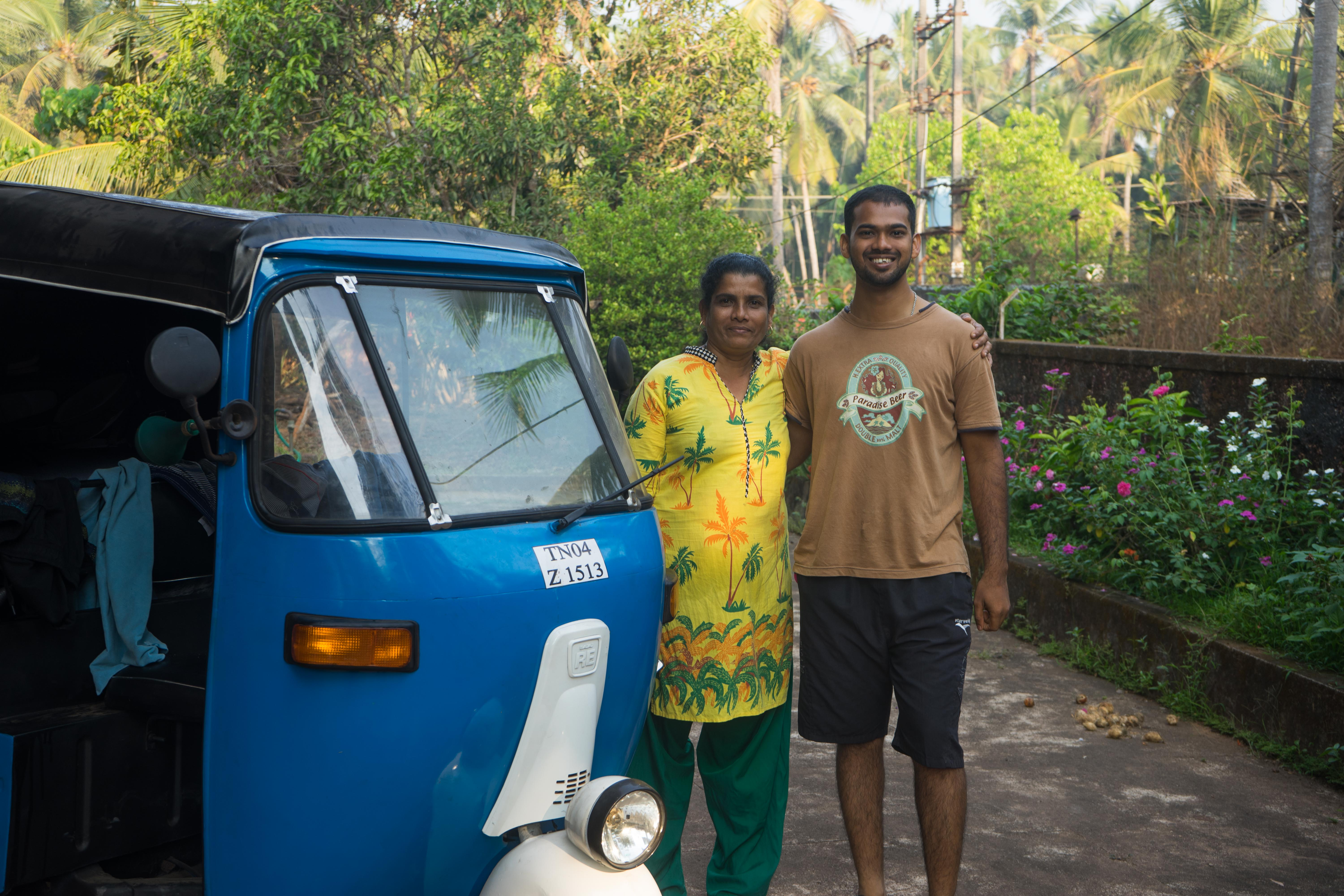Jayson, our Couchsurfing host in Mangalore, India, and his auntie standing besides our tuk tuk