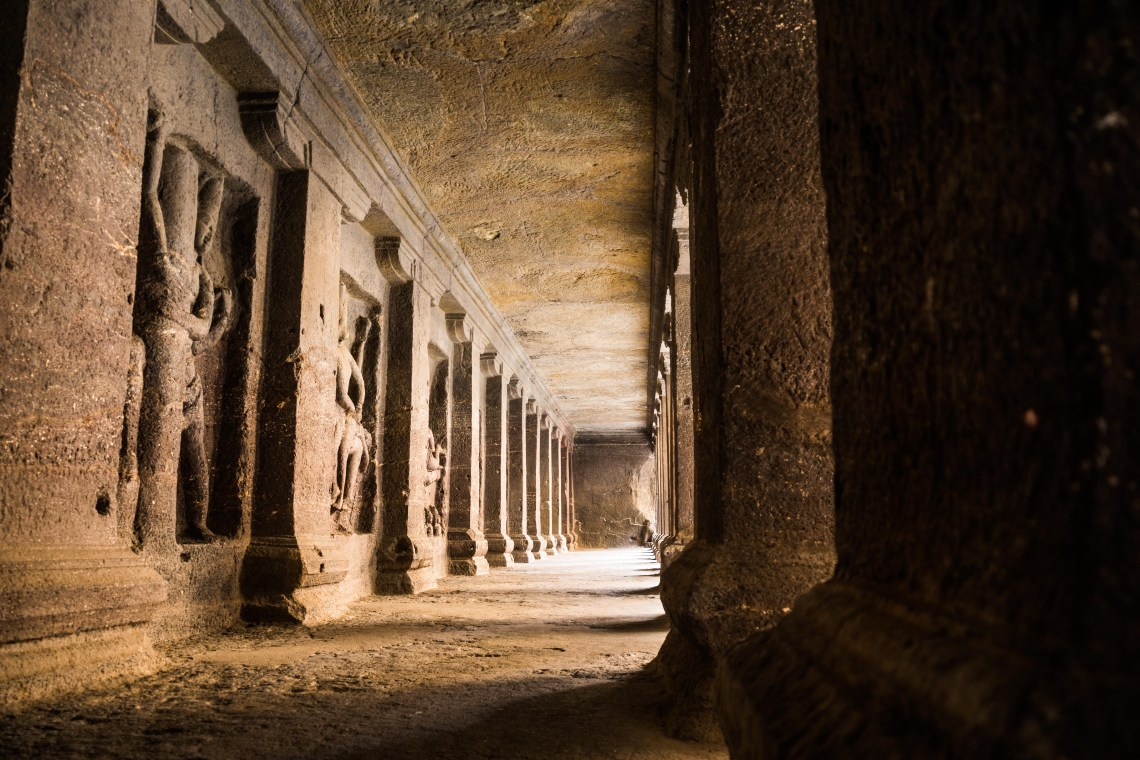 Ancient carvings and pillars as seen in Ellora Cave #17