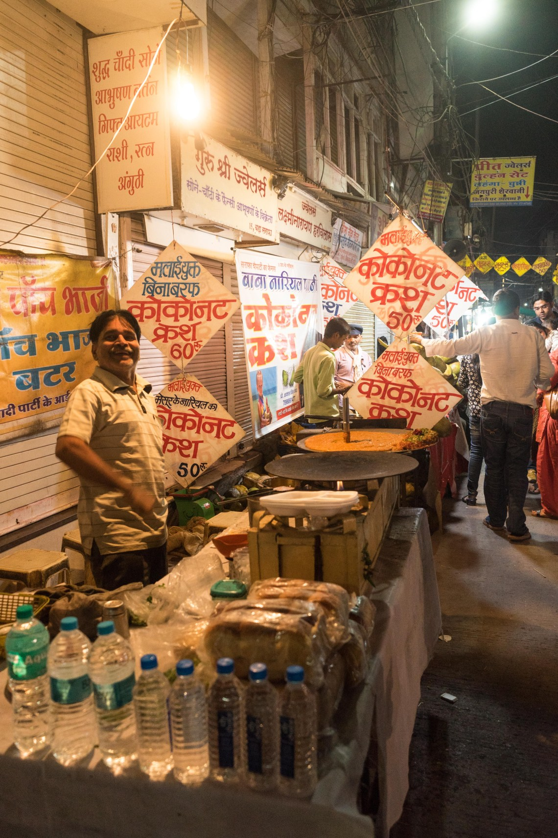 A street vendor selling food and water in Indore